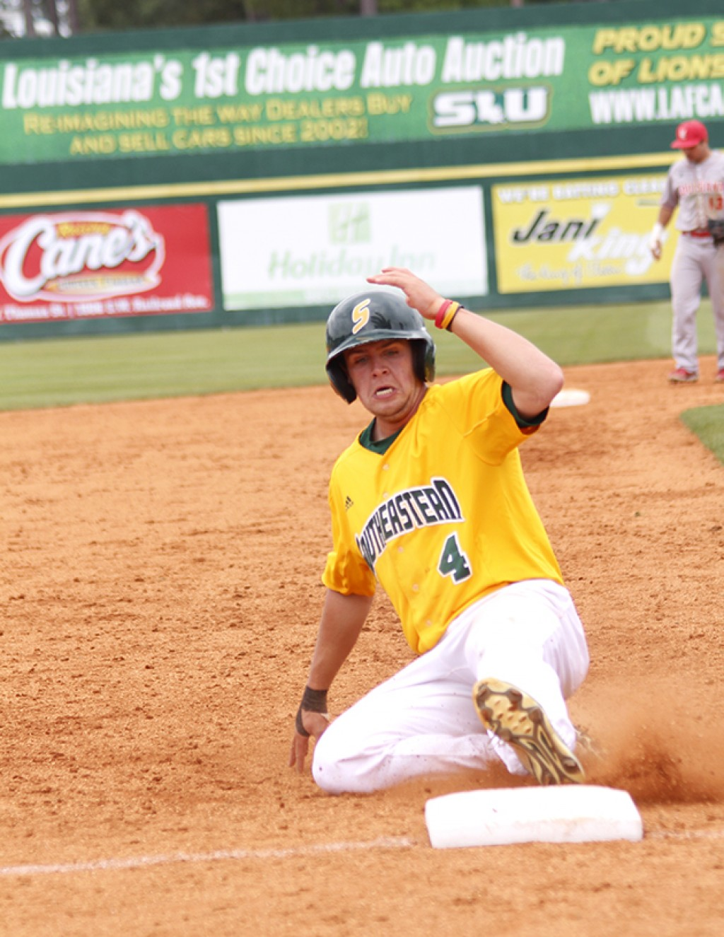 Sophomore left fielder Drew Avans slides into the third base. He finished the game with two hits and three RBI's.