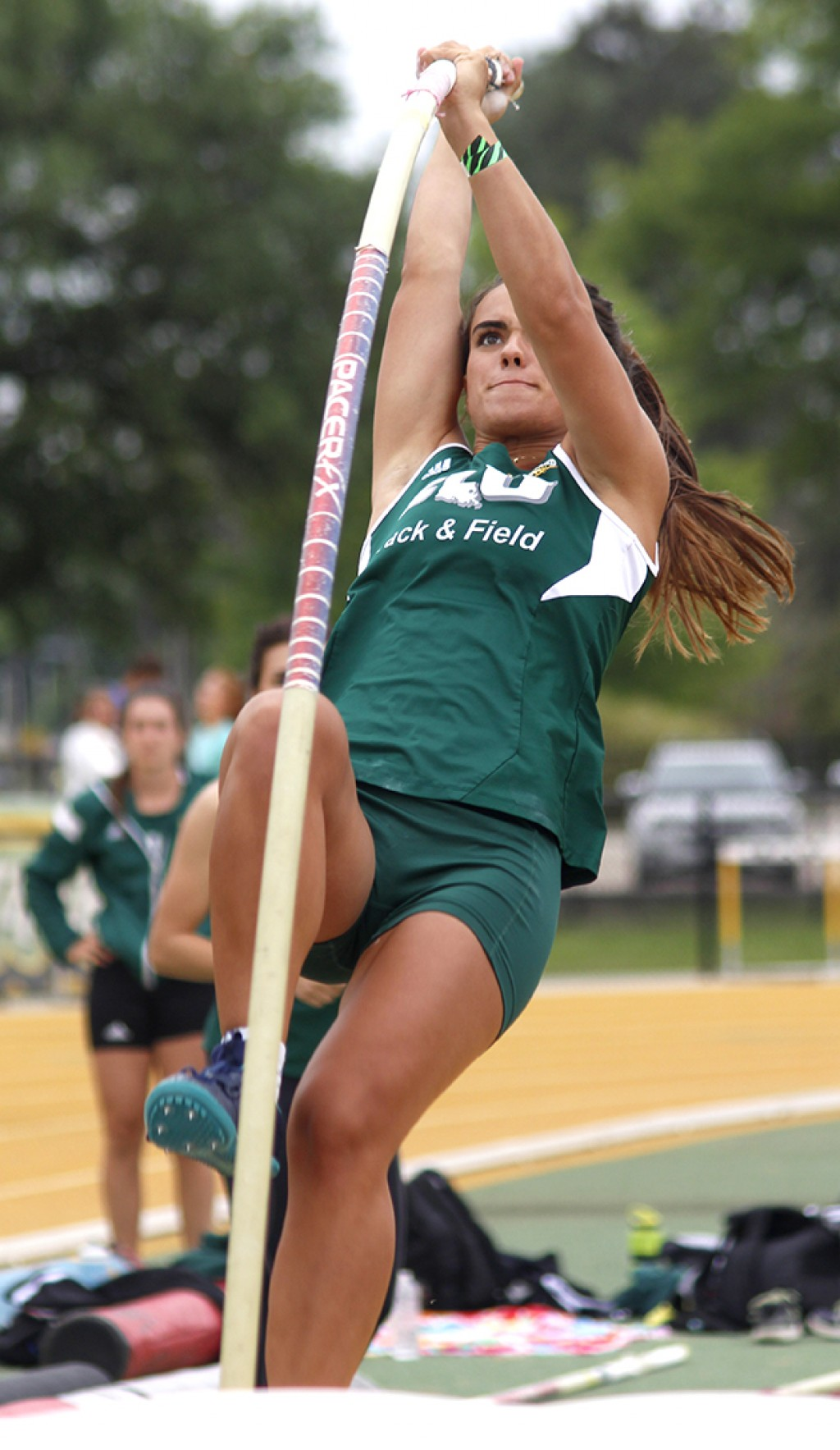 Senior Addison Martinez pole vaults during the Lion Invitational.
