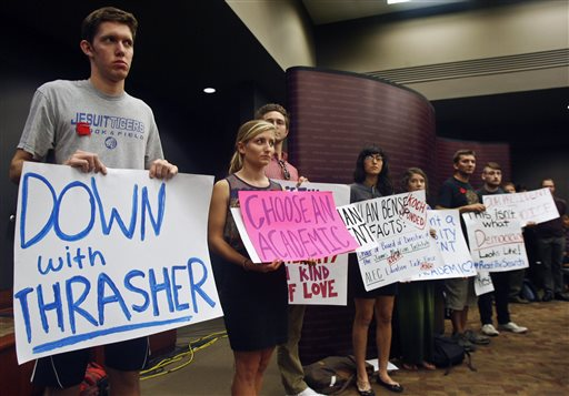 Students protest Florida State University presidential candidate state Sen. John Thrasher during a Board of Trustees meeting, Tuesday, Sept. 23, 2014 in Tallahassee, Fla. Despite significant campus opposition, the trustees voted 11-2 to select state Sen. John Thrasher as its next president. (AP Photo/Phil Sears)