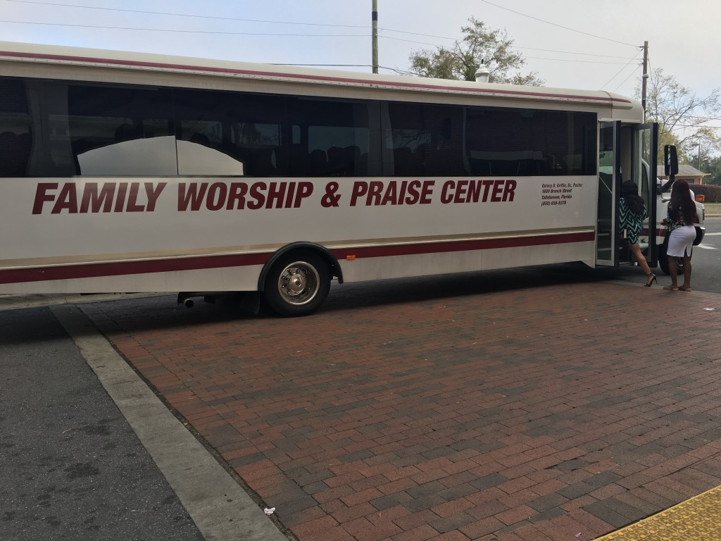 FAMU Village residents entering the shuttle for Family Worship and Praise Center's Sunday service. Photo by: Kayla Lawson