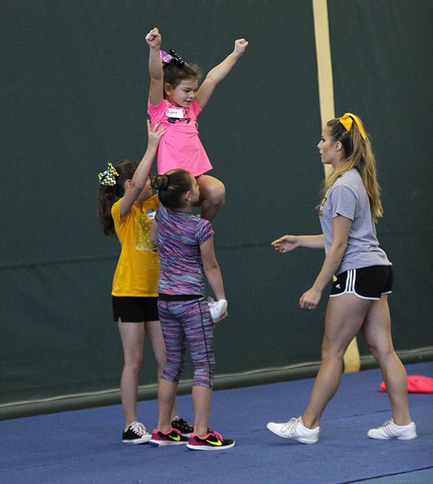 A cheerleader teaches stunting, right.