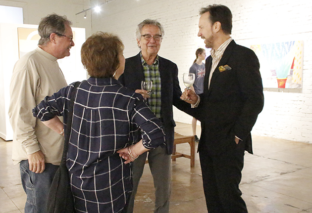 edet  tells the story behind his generational span of artwork to guests during what is possibly his final show in Hammond.