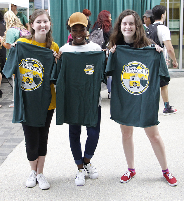 From left to right, Maddie Gallagher, a freshman art major, Zyria Guillory, a freshman art major and Aubree Weldon, a freshman art major, all enjoyed getting free Rommie's Road Trip themed T-shirts during the second annual Homecoming Kickoff, an event intended to vote for Rommie in the Mascot Challenge and to usher in the week's activities.