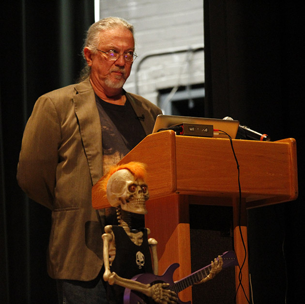 On Halloween, William Robison, Head of the Department of History and Political Science, gives a lecture about Frank Zappa, a rock and jazz singer and musician.